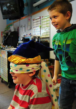Newbury: Lucian Densmore, left, tries to guess the disguised voice of classmate Mason Martinello, both 8, in Mary Ann Fraser's class at the Newbury Elementary School on Thursday. They were playing The Witches Hat, which they did at their Halloween party earlier in the week, to tell their parents about the game to perform at birthday parties and the like. Bryan Eaton/Staff Photo