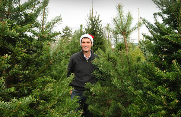 """Newburyport: Christmas Tree """"Santa"""" Alex Gramling is arranging to give 200 to area families in need of trees to decorate for the holidays. Bryan Eaton/Staff Photo"""