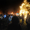 Salisbury:A crowd gathers around  the newly lit Christmas Tree in Salisbury Square Sunday night. staff photo