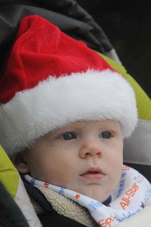 Newburyport: Seven-month-old James Fahey of Newburyport waits all snug in his cap for Santa to arrive for the annual Newburyport tree lighting. Jim Vaiknoras/staff photo