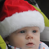 Newburyport: Seven-month-old James Fahey of Newburyport waits all snug in his cap for Santa to arrive for the annual Newburyport tree lighting. Jim Vaiknoras/staff photo