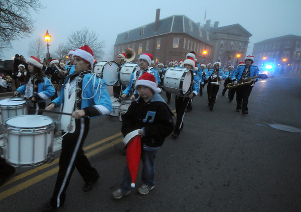 Newburyport: The Triton High School band marches up Water Street in the annual Newburyport Santa Parade. Jim Vaiknoras/staff photo