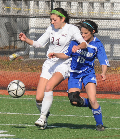 Lynn: Newburyport's Maryam Moshrefi fights for the ball with Stoneham's Hannah Martin during their victory in the North sectional final at Manning Field in Lynn Saturday. Jim Vaiknoras/staff photo