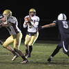 Byfield:Newburyport's Connor Wile looks downfield at Triton against Friday night. Jim Vaiknoras/Staff photo