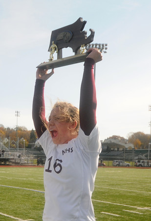 Lynn: Newburyport's Caitlin O'Connor holds up the trophy their victory in the North sectional final at Manning Field in Lynn Saturday. Jim Vaiknoras/staff photo