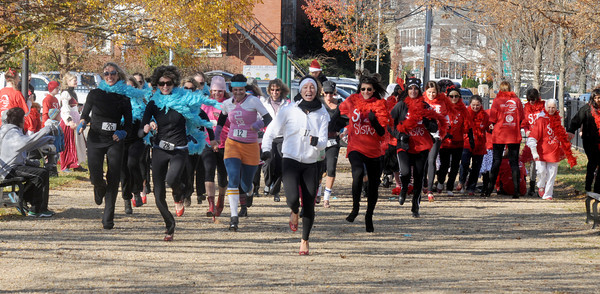 Newburyport: Runners take off at  the start of  the 2nd annual The  Heart & Sole High Heel Dash at the Bartlet Mall Saturday. The event sponsered by Interlocks Salon & Day Spa and the Anna Jaques Hospital raised awareness for women's heart health. staff photo