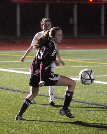Woburn: Gloucester's Caroline Greeke turns with the ball during their game at Woburn High. Jim vaiknoras/staff photo