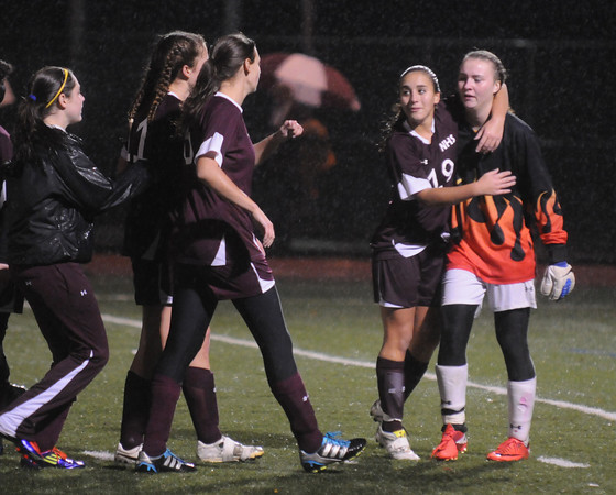 Lynn: Newburyport teammate console each other after the Clippers 3-0 loss to Canton in the state semi-final game at Manning Field in Lynn. JIm Vaiknoras/staff photo