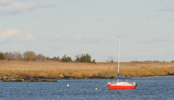 Newburyport: A boat sits alone in the Merrimack River off Newburyport in the soft afternoon sunlite. Jim Vaiknoras/staff photo