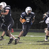 Byfield: Triton's Derek Paquette gains yardage against Winthop at home Friday night. Staff photo