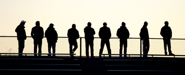 Newburyport: Soccer fans are silhouettes against the setting sun during the Clippers home game against Winthrop Saturday at World War Stadium in Newburyport. JIm Vaiknoras/Staff photo