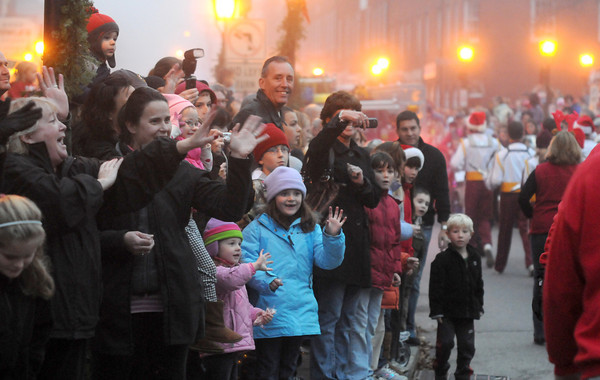 Newburyport: Crowds wave in Market Square as Santa rides by during the annual Newburyport Santa Parade. Jim Vaiknoras/staff photo