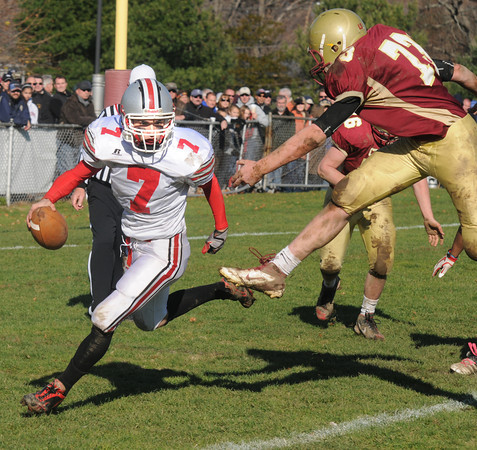 Newburyport:Amesbury's Matt Talbot scrambbles under pressure from Newburyport's Dillon Guthro during their game  at World War Memorial Stadium in Newburyport Thursday. Jim Vaiknoras/staff photo