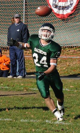 West Newbury: Pentucket's Cody Rothwell fields a blocked punt, a play in which he scored, during their game against Newburyport at Pentucket Saturday. Jim Vaiknoras/Staff photo