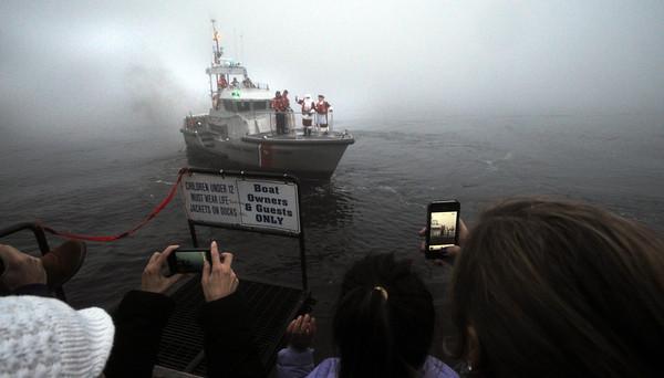 Newburyport:The Coast Guard brings Santa down the Merrimack River in heavy fog for the annual Newburyport Santa Parade. Jim Vaiknoras/staff photo