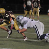Andover: Hamilton-Wenham Shane Jenkins tackle Newburyport's Jared Bradbury at Andover high Tuesday night. Jim Vaiknoras/staff photo