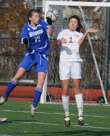 Lynn: Newburyport's Aly Leahy goes up for a ball with Stoneham's Danielle Phalon during the Clipper victory in the North sectional final at Manning Field in Lynn Saturday. Jim Vaiknoras/staff photo