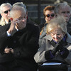 Newburyport: Byron Matthews and his wife, Helen, get emotional as they listen to Byron's brother, Nick, speak about their parents at the dedication of Byron's Court on Inn Street in Newburyport. Jim Vaiknoras/Staff photo