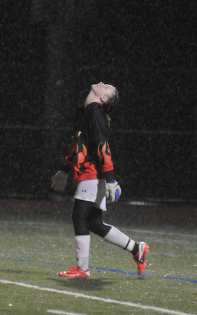 Lynn: Newburyport goalkeeper Lilly Donovan turns her face up tp the falling rain after the Clippers 3-0 loss to Canton in the state semi-final game at Manning Field in Lynn. JIm Vaiknoras/staff photo