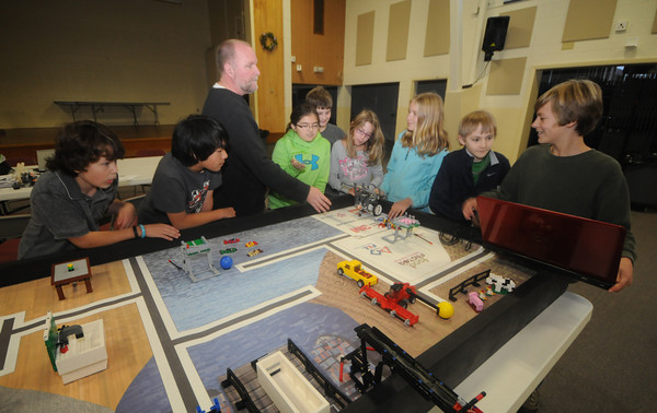 West Newbury: Coach Bill Bachrach, works with the Pentucket 6th grade Lego Team from left: Nick Vecchi, Min Bachrach, Danielle Arsenault, Molly Balentine, Chris Yates, Allie Jarret, Thomas Moura and Chris Jarret at teh 1910 building in West Newbury. JIm Vaiknoras/staff photo