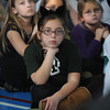 West Newbury: Elisabeth Riley , a student at the Paige School, looks on as Sergeant Daniel Cena and Officer Eric Forni of the West Newbury Police Department  speak with students about how to stay safe while out Trick-o-Treating next Monday. As part of an ongoing outreach effort to strengthen police relationships with younger residents in town, Cena and Forni spoke about 'stranger danger', inspecting candy, and reporting crimes and vandalism to adults and the police. At the end of the presentation, students were given battery operated glow sticks to take with them on their annual Halloween trek for candy. The glow sticks were purchased through the generosity of Osram Sylvania -- the firm where Cena's wife, Janet, works -  with money from the Kenny Fowler Car Show Fund.