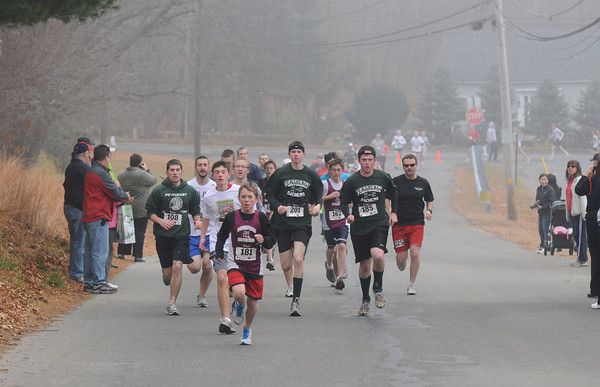 WEST  Newbury: Runners head up Farm Lane in West Newbury at the second annual Pentucket Pride 5K Road Race Sunday morning. Staff photo