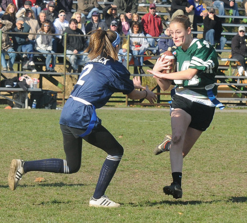 West Newbury: Pentucket's Emily Tradd makes a move on Triton's Makiala Ferrick during their annual Powder Puff game at Pentucket Saturday. staff photo