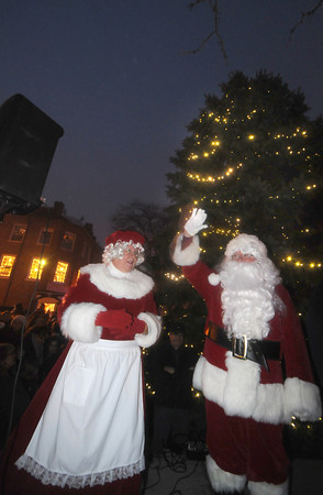 Newburyport: Santa and Mrs. Claus wave in Market Square at the annual Newburyport Santa Parade and tree lighting. Jim Vaiknoras/staff photo