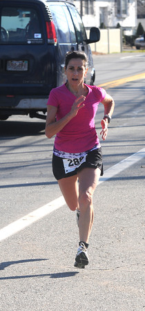 Salisbury: Maryann MacNeil wins of the Timmy Trot 5k race honoring Salisbury firefighter Timothy Oliveira who was killed this past summer. Jim vaiknoras/staff photo