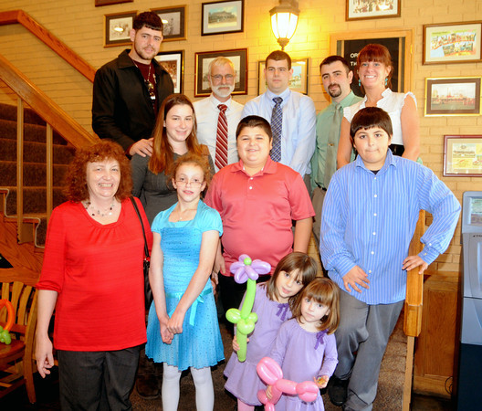 Salisbury:From the top left: Son in law Hector Almagra, Paul Pouliot, Nathan Pouliot, Paul Pouliot III, his wife Kim,  middle row: Rosanna Pouliot Almagra , grandsons Dylan and Tyler Pouliot, Barbara Pouliot, Melissa Pouliot, granddaughters Phoebe and Karleigh Pouliot celebrate at the Sylvan Street Grill in Salisbury, the adobtion by Barbara and Paul of Melissa. JIm Vaiknoras/staff photo