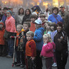 Newburyport: Crowds line Market Square waiting to catch a glimpse of Santa at the annual Newburyport Santa Parade and tree lighting. Jim Vaiknoras/staff photo