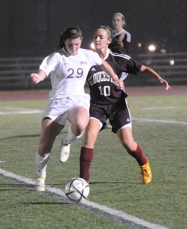 Woburn: Newburyport's Liza Twomey fights for the ball with Gloucester's Hannah Sperry during their game at Woburn High. Jim vaiknoras/staff photo