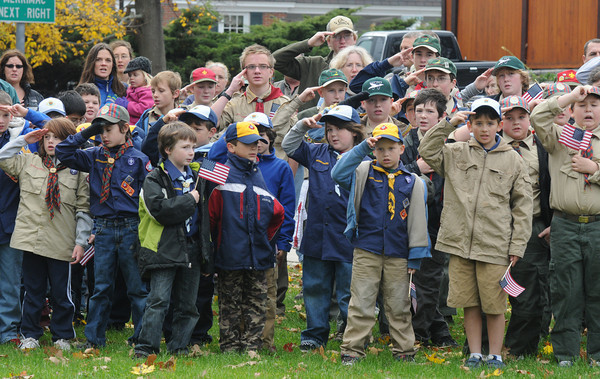 Amesbury: Scout salute the flag during the playing of the National Anthem at the Veteran's Day service at Amesbury Middle School. Jim Vaiknoras/staff photo