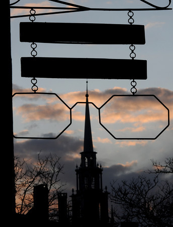 Newburyport: The steeple of the First Religious Society Church appare to be looking trough the giant eye glasses on the sign at the Optical Shop in Market Square in Newburyport. Jim Vaiknoras/staff photo