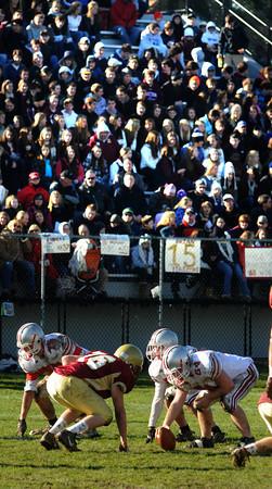Newburyport: Newburyport's nose tackle Justin Johnson lines up against Amesbury center Matt Lazor infront of a huge crowd during their game  at World War Memorial Stadium in Newburyport Thursday. Jim Vaiknoras/staff photo