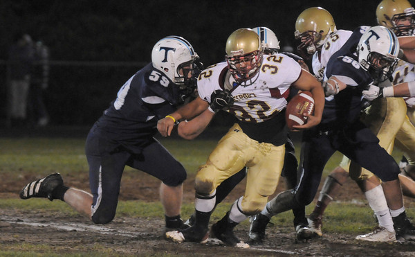 Byfield: Triton's Ryan Clay tackles Newburyport's Tyler Martin for a loss at Triton against  Friday night. Jim Vaiknoras/Staff photo