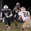 Byfield: Triton's Blaise Whitman looks downfield for a reciever against Winthop at home Friday night. Staff photo
