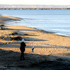 Newbury: A woman walks her dog along the beach on Plum Island at Sunset. Jim Vaiknoras/staff photo