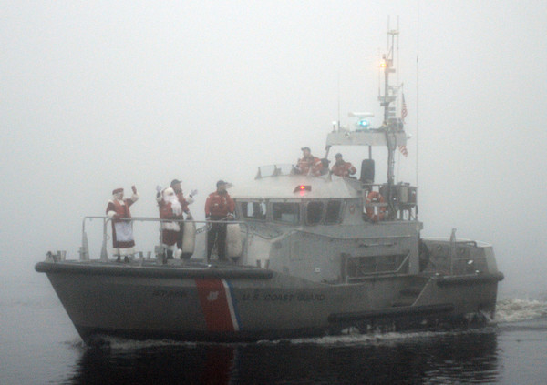Newburyport: The Coast Guard brings Santa down the Merrimack River in heavy fog for the annual Newburyport Santa Parade. Jim Vaiknoras/staff photo