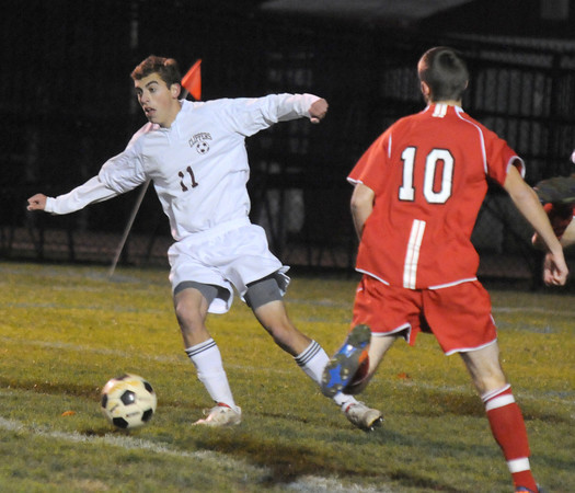 Newburyport: Newburyport's Harrison Corbett kicks the ball past Amesbury's Adam Ivancic during their game at Newburyport Friday night. Jim Vaiknoras/Staff photo