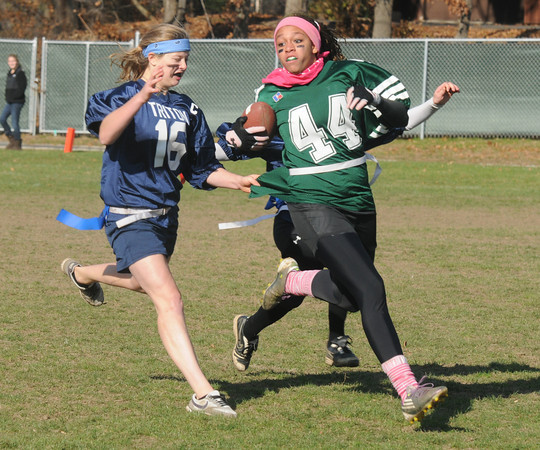 West Newbury: Pentucket's Sarah Higgins tries to turn the corner as she is caught by Triton's Sydney White during their annual Powder Puff game at Pentucket Saturday. staff photo