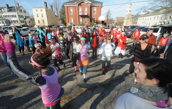 Newburyport: Runners warm up before the start of  the 2nd annual The  Heart & Sole High Heel Dash at the Bartlet Mall Saturday. The event sponsered by Interlocks Salon & Day Spa and the Anna Jaques Hospital raised awareness for women's heart health. staff photo