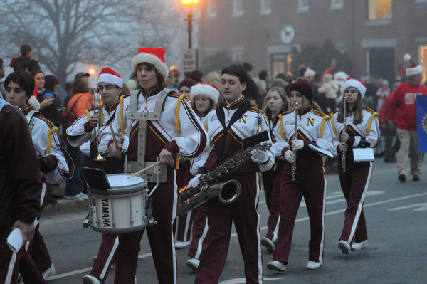 Newburyport: The Newburyport High School band marches up Water Street in the annual Newburyport Santa Parade. Jim Vaiknoras/staff photo