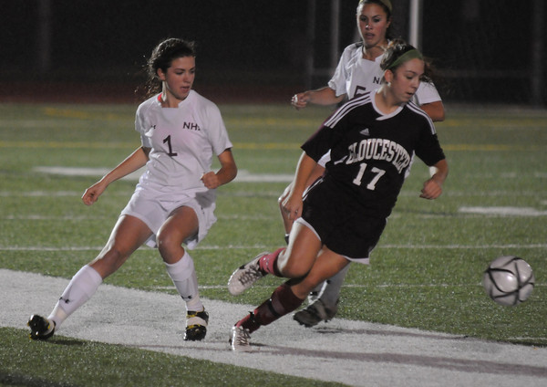 Woburn: Gloucester's Bianca Giacalone takes the ball away from Newburyport's Aly Leahy during their game at Woburn High. Jim vaiknoras/staff photo