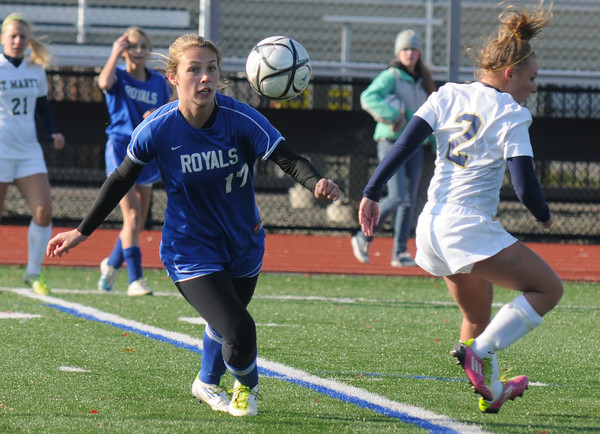 Lynn: Georgetown's Nicoline Holland keeps her eye on the ball the Royal's sectional finals game against St Mary's at Manning Field in Lynn Saturday. Jim Vaiknoras/staff photo