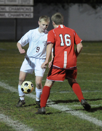Newburyport: Newburyport's Jordan Steelman makes a move on Amesbury's Alec Wade during their game at Newburyport Friday night. Jim Vaiknoras/Staff photo