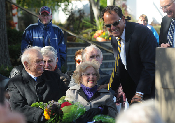 Newburyport: Peter Matthews give flowers to his mom, Helen, at the dedication of Byron's Court, named for his father, on Inn Street in Newburyport. Jim Vaiknoras/Staff photo