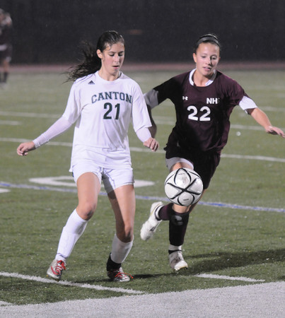 Lynn: Newburyport's Nicole Galer fights for a loose ball with Canton's Kayla Laughlin during the Clippers 3-0 loss to Canton in the state semi-final game at Manning Field in Lynn. JIm Vaiknoras/staff photo