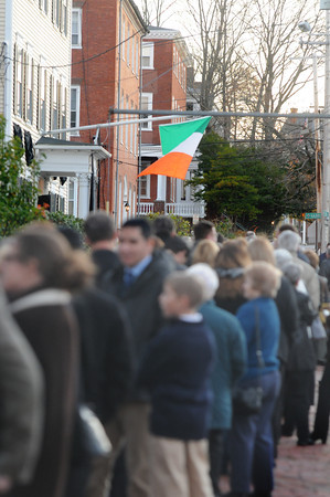 Newburyport: The Irish Flag flies at Rogers Funeral Home on Green Street in Newburyport as a large line forms to pay their respects to Dick Sullivan who died Wednesday. Jim Vaiknoras/Staff photo