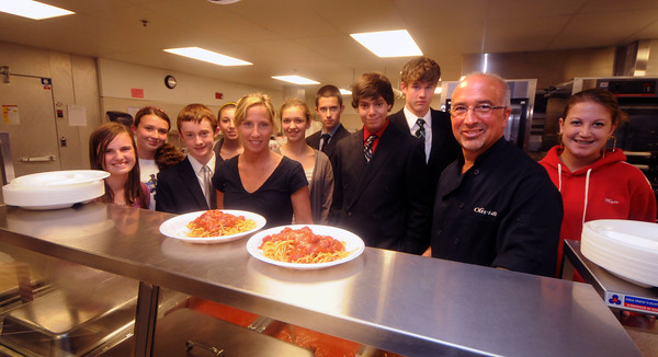 Amesbury: Stephen and Suzanne Petrou owners of Krugers Flatbread and Olivia's cooked and donated all the food for the Amesbury High Freshman Spagetti Dinner Fundraiser at the school Wednesday night. Here they pose withe the class of 2015 class officers. The couples twin daughters are freshman at the school. Staff photo
